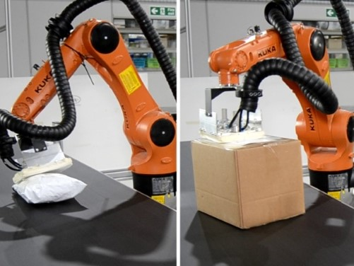 Robot labelling parcels of differing sizes and shapes, robot head is angled to be normal to parcel surface.