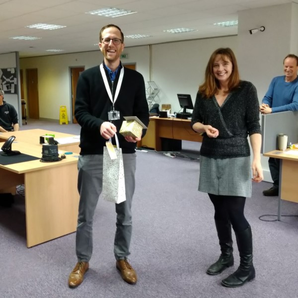 Loop Technology Employee receives long service award in the office